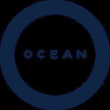 Ocean Logo design with navy blue circle.